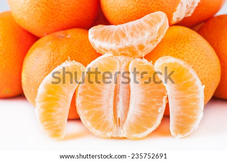 Clementina with peeled cloves separated - stock photo