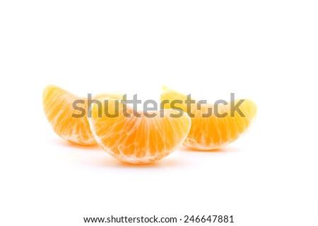 Clementine orange wedges isolated over white background. - stock photo