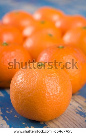 Clementines on a blue table