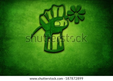 clenched fist on green background - stock photo
