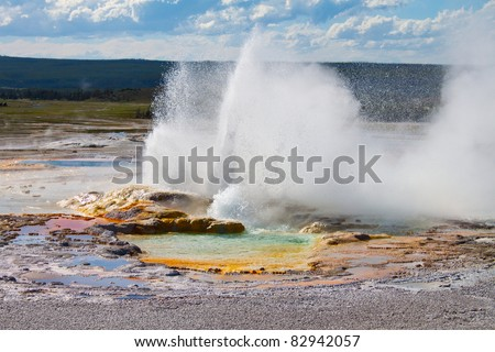 Clepsydra Geyser located in the Fountain Paint Pot area of Yellowstone - stock photo