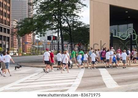 CLEVELAND - AUGUST 27 : Participants in the 2011 Cleveland Heart Walk, sponsored by the American Heart Association, make their way down a major street in Cleveland on August 27 2011.
