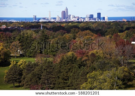 Cleveland - distant skyline view with colorful trees in the foreground. - stock photo