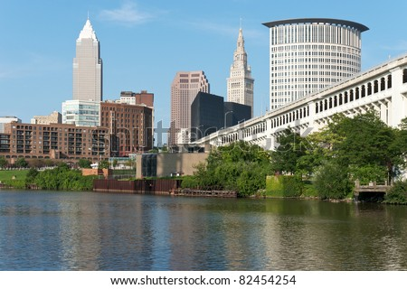 Cleveland From The River Commercial and residential buildings in the downtown area of Cleveland, Ohio as seen from the bank of the Cuyahoga River - stock photo