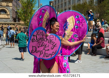 CLEVELAND, OH - JULY 20, 2016: A colorful protester dressed as a butterfly shares an anti-Trump message on Public Square during the Republican National Convention. - stock photo