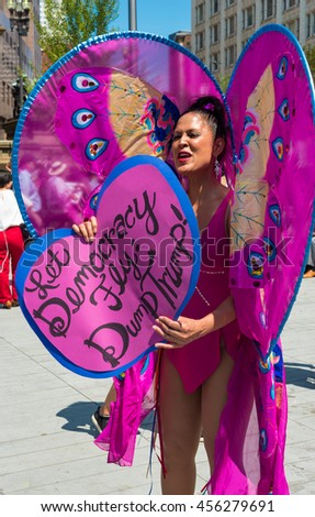 CLEVELAND, OH - JULY 20, 2016: A colorful protester dressed as a butterfly shares an anti-Trump message on Public Square during the Republican National Convention.