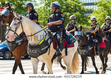 CLEVELAND, OH - JULY 20, 2016: Cleveland Mounted Police ride onto Public Square as part of the vast peacekeeping force during the Republican National Convention. - stock photo