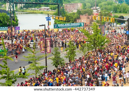 CLEVELAND, OH - JUNE 22, 2016: Massive crowds line the streets next to the Q in anticipation of the victory parade celebrating the Cleveland Cavaliers' first NBA championship three nights earlier. - stock photo