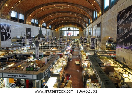 CLEVELAND, OH - JUNE 27: The famed West Side Market in Cleveland, Ohio, celebrating 100 years of continuous operation in 2012, opens for business in the early morning of June 27, 2012. - stock photo