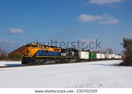 CLEVELAND, OH - November 15: Norfolk Southern locomotive 1071 in the Jersey Central Lines Heritage paint scheme makes an infrequent trip through Cleveland, Ohio on a snowy November 15th, 2014 - stock photo