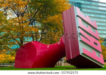 CLEVELAND, OH - OCTOBER 5: The Free Stamp sculpture, created by Claes Oldenburg and Coosje van Bruggen, has been the focus of Willard Park in Cleveland Ohio since 1991. Photo taken on October 5, 2013. - stock photo