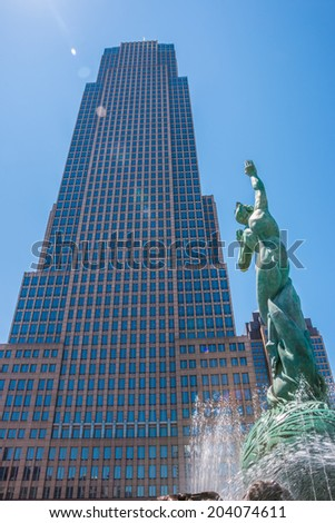 CLEVELAND, OHIO - JULY 4 2014: The Fountain of Eternal Life statue and fountain in front of the Key Tower, the tallest building in Ohio. Located in Cleveland. - stock photo