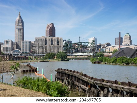 CLEVELAND, OHIO - JULY 11: The new Scranton Flats Towpath Trail recreation area offers visitors scenic views such as this of the Cuyahoga River and downtown Cleveland, Ohio as seen on July 11, 2014. - stock photo