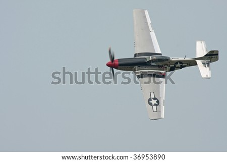 CLEVELAND, OHIO - SEPT. 6: a P-51 Mustang fighter aircraft flies at the Cleveland National Airshow on Sept. 6, 2009 in Cleveland, Ohio. - stock photo