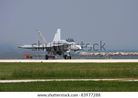 CLEVELAND, OHIO - SEPT. 3: F/A-18 Hornet fighter jet performs at the Cleveland National Airshow on Sept. 3, 2011 in Cleveland, Ohio. - stock photo