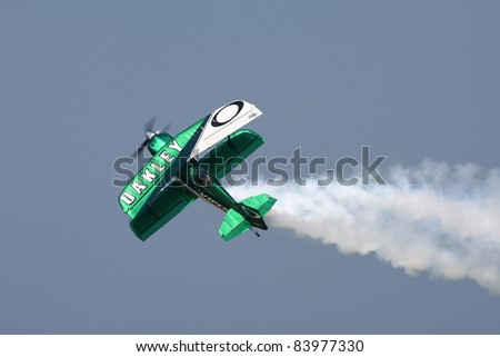 CLEVELAND, OHIO - SEPT. 3: Oakley acrobatic stunt plane performs at the Cleveland National Airshow on Sept. 3, 2011 in Cleveland, Ohio. - stock photo