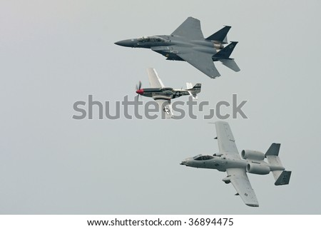 CLEVELAND, OHIO - SEPT. 6:  Three fighter aircraft flying together. A P51, an A10, and a F15 at the Cleveland National Airshow on Sept. 6, 2009 in Cleveland, Ohio. - stock photo