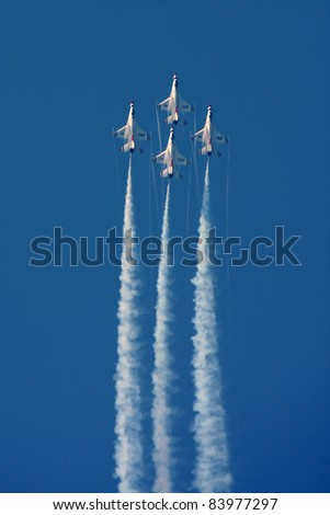 CLEVELAND, OHIO - SEPT. 3: U.S.A.F. Thunderbirds performs at the Cleveland National Airshow on Sept. 3, 2011 in Cleveland, Ohio. - stock photo