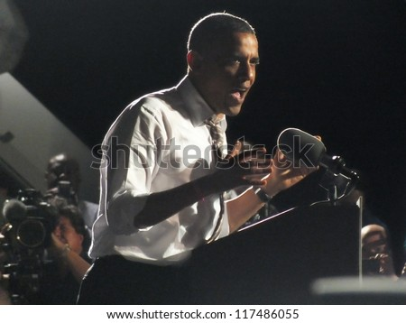 CLEVELAND, OHIO, USA - OCTOBER 25, 2012: On President Obama addresses a crowd while at a campaign stop at Burke Lake Front Airport on October 25,2012 in Cleveland, Ohio, USA. - stock photo