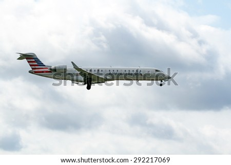 CLEVELAND, USA - JUNE 30, 2015: American Airlines American Eagle Bombardier CL-600-2C10 at Cleveland Hopkins International Airport.