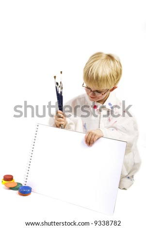 clever boy is proud on his blank painting - stock photo
