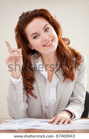 Clever business woman working at the office and having an idea - stock photo