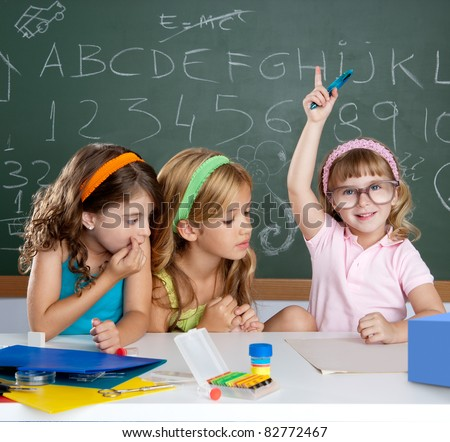 clever children student girl raising hand at school classroom - stock photo