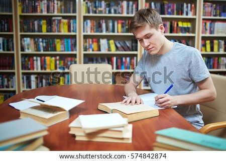 Clever Guy Sitting By Desk Library Stock Photo (Safe To Use) 574842874    Shutterstock