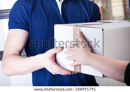 Client and courier during order transfer, horizontal - stock photo