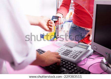 Client paying with credit card in pharmacy. Inside shooting. Alternative payment. Credit card. Drug and pills. Business - stock photo