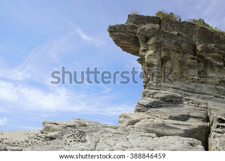 Cliff against blue sky