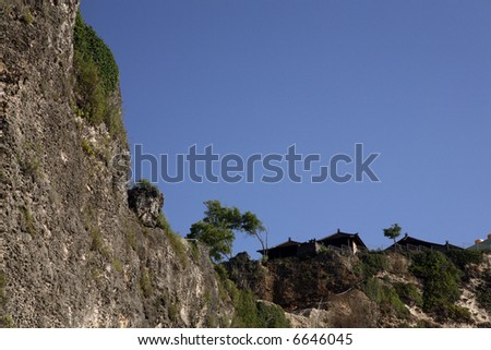 cliff and blue skies - stock photo