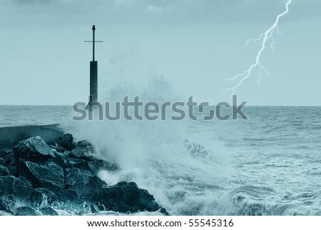 cliff and waves during the storm - stock photo