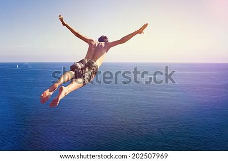 Cliff Diver - stock photo