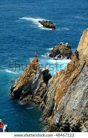 Cliff divers in Acapulco - stock photo