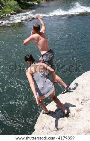 Cliff jumping into a mountain river in Montana - stock photo