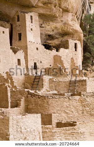 Cliff Palace in Mesa Verde National Park in southern Colorado. The holes with ladders are kivas, underground chambers used for ceremonies and meetings. - stock photo