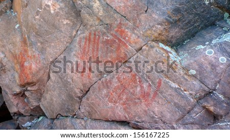Cliff rock painting of Ojibwe People in Bon Echo Park in Ontario, Canada - stock photo
