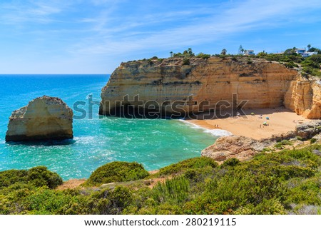 Cliff rocks and beautiful beach with turquoise sea water near Carvoeiro town on coast of Portugal