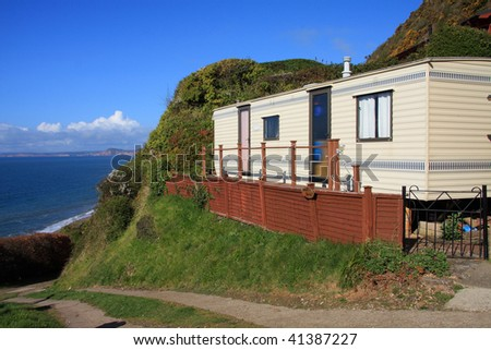 Cliff sited caravan overlooking the sea in Devon, UK - stock photo
