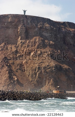 Cliff with monument on the top - stock photo