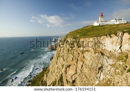 Cliffs and lighthouse of Cabo da Roca on the Atlantic Ocean in Sintra, Portugal, the westernmost point on the continent of Europe - stock photo