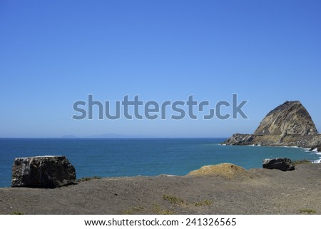 Cliffs and rocks along PCH-1 in Ventura County near Point Mugu, Southern California - stock photo
