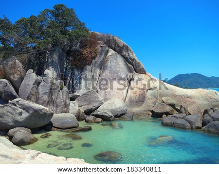 Cliffs and rocks in ocean at Koh Samui, Thailand - stock photo