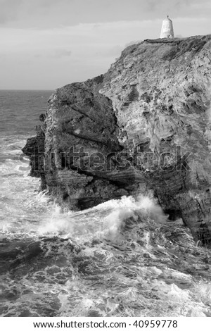 Cliffs and the Pepperpot Daymark in Portreath on a stormy day.