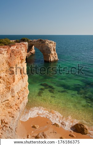 Cliffs and transparent water in Algarve, Portugal, wild beach