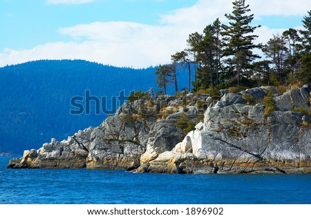 Cliffs and trees in WhyteCliff Bay at Vancouver. More with keyword group14k