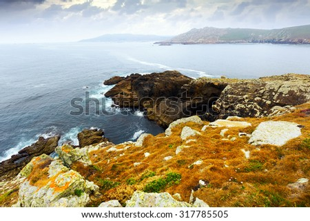 Cliffs at ocean  coast  in tranquil grey day