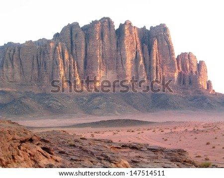 Cliffs at sunrise in Wadi Rum in Jordan in the Middle East - stock photo
