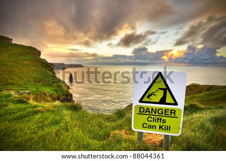 Cliffs can kill sign on Cliffs of Moher, Co. Clare, Ireland - stock photo